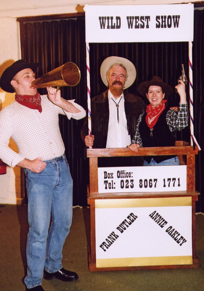 Photograph:  Touting for Business - Buffalo Bill (centre) played by Colin Sly, joined by two members of his Wild West Show.