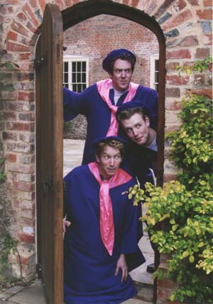 Photograph: Hilarion, Cyril and Florian sneak into the college disguised as female undergraduates